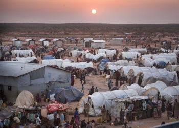 View of a refugee camp at sunset