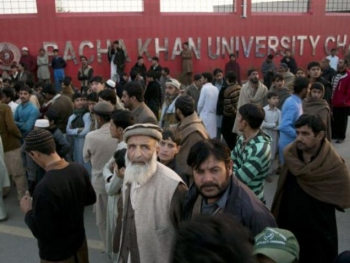 Family members of students stand outside the Bacha Khan University in Charsadda town, 35 km outside the city of Peshawar