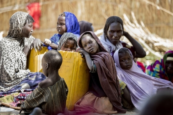 Chadian children with their mothers in a displacement camp