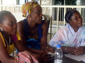 During consultations, three women from Abobo and Yopougon listen to their peers' recommendations for reparations policies.
