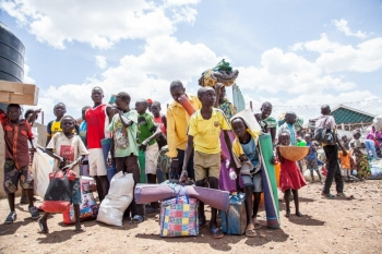 A group of young people on the Kenyan border after fleeing Sudan