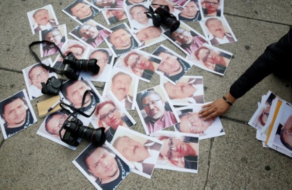 Pictures of murdered Mexican journalists exhibited during a protest after the killing of Javier Valdez in Mexico City, May 16