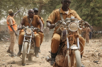 Burkinabe volunteer fighters driving their motorbikes