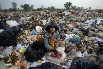 Child eating garbage and wasted food