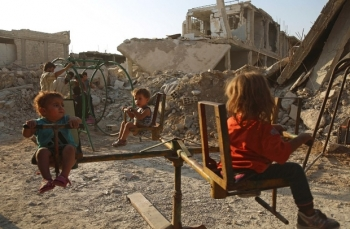 Children play in the destroyed rebel-held town of Douma, near Damascus.
