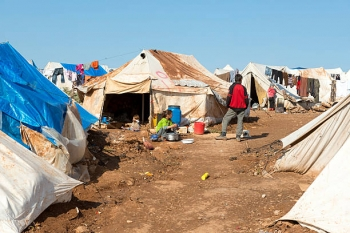 Damaged tents in aSyrian refugee camp