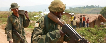 Armed forces of the DRC patrolling a village in Ituri