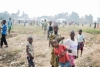 Kids playing on the mass graves in the Nganza area, in the capital of Kasai, Kananga.