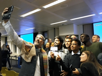 Together against child exploitation: Nobel Peace Prize Kailash Sathiarthy takes a selfie with a  group of students