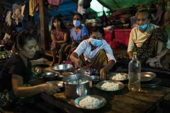 Women preparing dinner in a displaced people camp in Mrauk U, Myanmar, August 2020