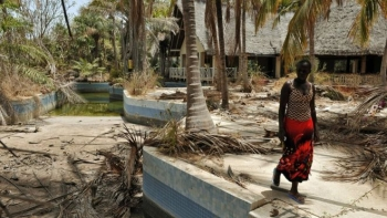 A woman walking in Casamance: the region used to be a touristic destination