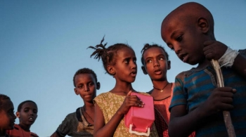 Ethiopian children who fled Tigray wait for food to be distributed in Gadaref refugee camp, eastern Sudan