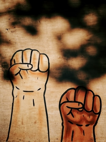 Artwork of raised fists representing justice