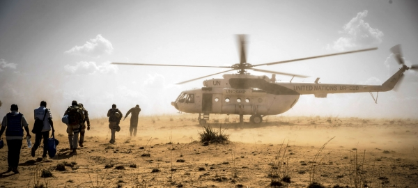 UN peacekeepers return to their helicopter, Mopti region, central Mali.