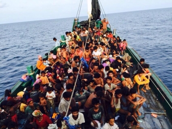 Off the coast of Malaysia, hundreds of Rohingya seek safety by boat