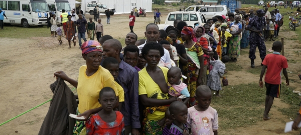 Congolese refugees wait in line for the verification process in Uganda.