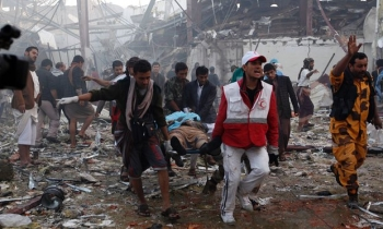 Aid workers rush to help after an explosion at the Sanaa funeral