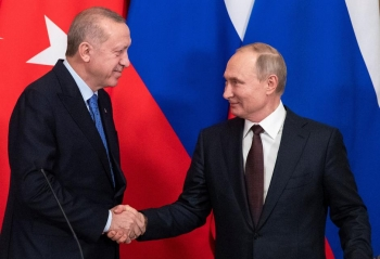 Turkish and Russian leader shake hands in Moscow after announcing new ceasefire in Idlib