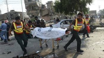Rescue workers move the body of a victim of the explosion.