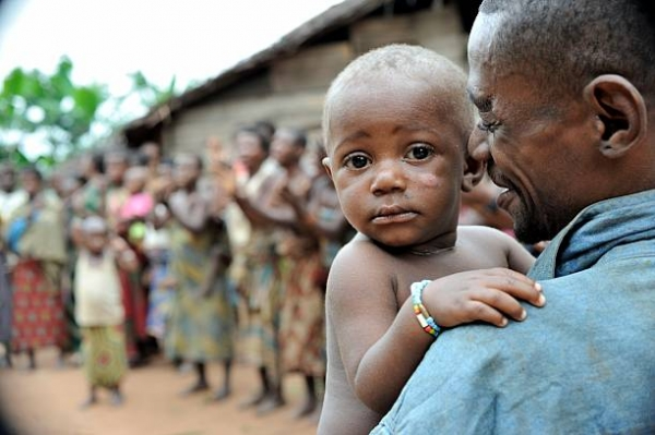A child in a man's arms in the Central African Republic.