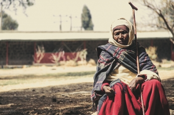 A woman waits outside church in Addis Ababa, the capital of Ethiopia