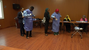 Sudanese healthcare professionals wear personal protective equipment (PPE) to assist suspected COVID-19 patients