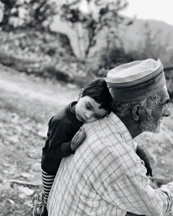 A child with an elderly man