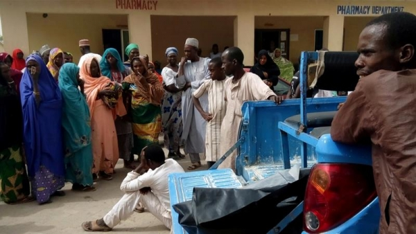 Civilians react at hospital after a suspected Boko Haram attack in Maiduguri