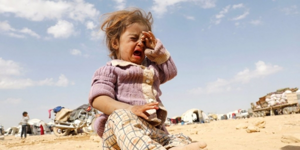 Syrian child crying lost and alone in a refugee camp