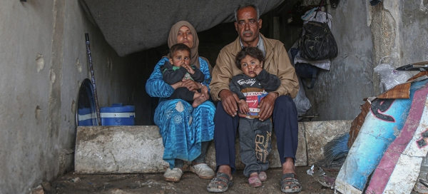 An internally displaced family in a damaged school in the town of Binish in Idlib, Syria