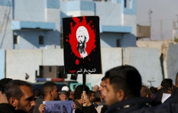 Supporters of Shi'ite cleric Moqtada al-Sadr protest against the execution of Shi'ite Muslim cleric Nimr al-Nimr in Saudi Arabia, during a demonstration in Baghdad January 4, 2016.