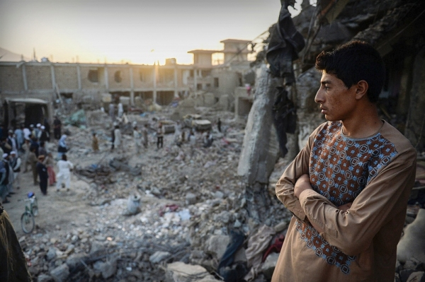 A young man looks across the devastation caused by a massive truck bomb in Kabul, Afghanistan, on Aug. 7, 2015.