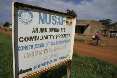 Sign that acknowledges a World Bank program of financing in a community project in Uganda