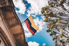 The Colombian flag waving over a building in Bogota