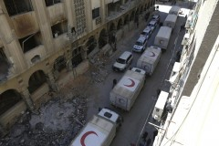 Aid convoy driving through the streets of Douma, Eastern Syria
