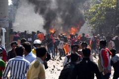 Smoke rises from a clash in Delhi where Hindus supporting a new citizenship law faced off against Muslims opposed to it.