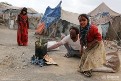 Internally displaced people are forced to make makeshift shelters with scrap wood and plastic tarps