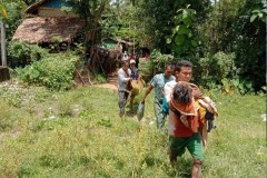 Residents flee Nyaung Khet Kan village after it is struck with artillery shells on the morning of 8 September Credit:
