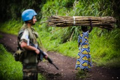 Woman crosses a road patrolled by peacekeepers