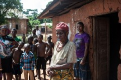 An elderly woman outside her house in Nimbo, Nigeria, after an attack by an AOG