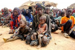 This group of refugee women in Niger is waiting for aid to be distributed by UNHCR staff