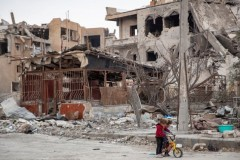 Children play among ruins in Raqqa