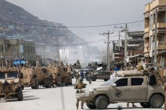 Afghan forces near the Sikh complex in Kabul, after the attack