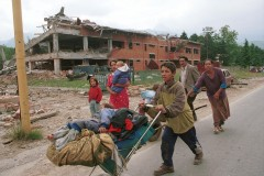 Kosovo civilians fleeing their home, Kosovo Polje, June 1999
