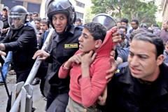 Young man arrested by Egyptian police during a protest in Cairo